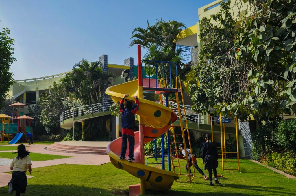 a playground with a yellow winding slide