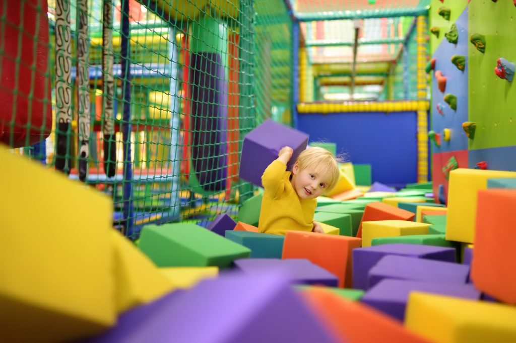 a child playing in a foam play area